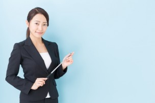 portrait of asian businesswoman on blue background
