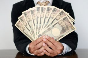 Businessman holding bills